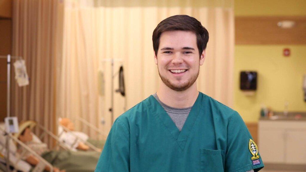 Photo of a male undergraduate nursing student.
