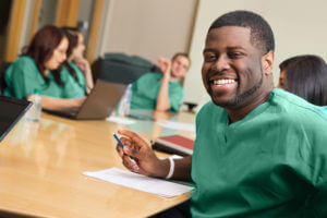 Photo of an African American Master of Science in Nursing student smiling