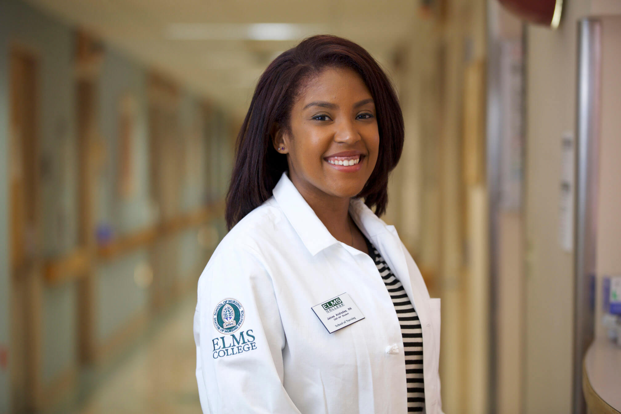 Photo of a female doctor of nursing practice, adult-gerontology acute care nurse practitioner student