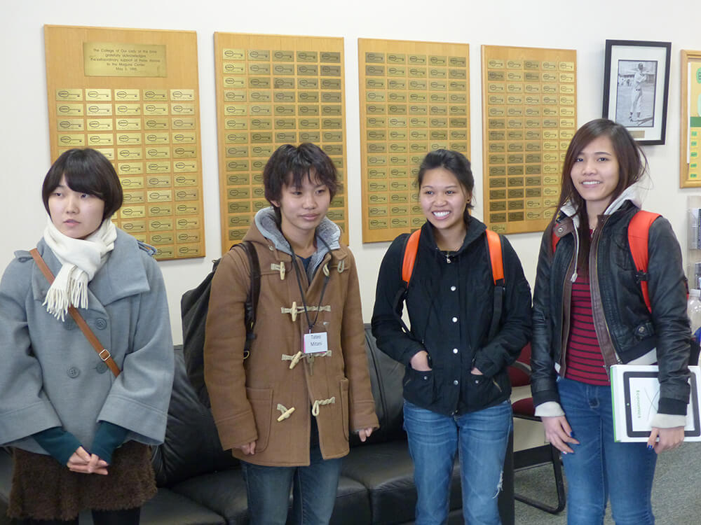 Photo of healthcare management graduate Tam Le with University of Kochi exchange students