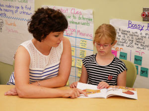 Photo of MaryKate Sullivan and a summer reading program student