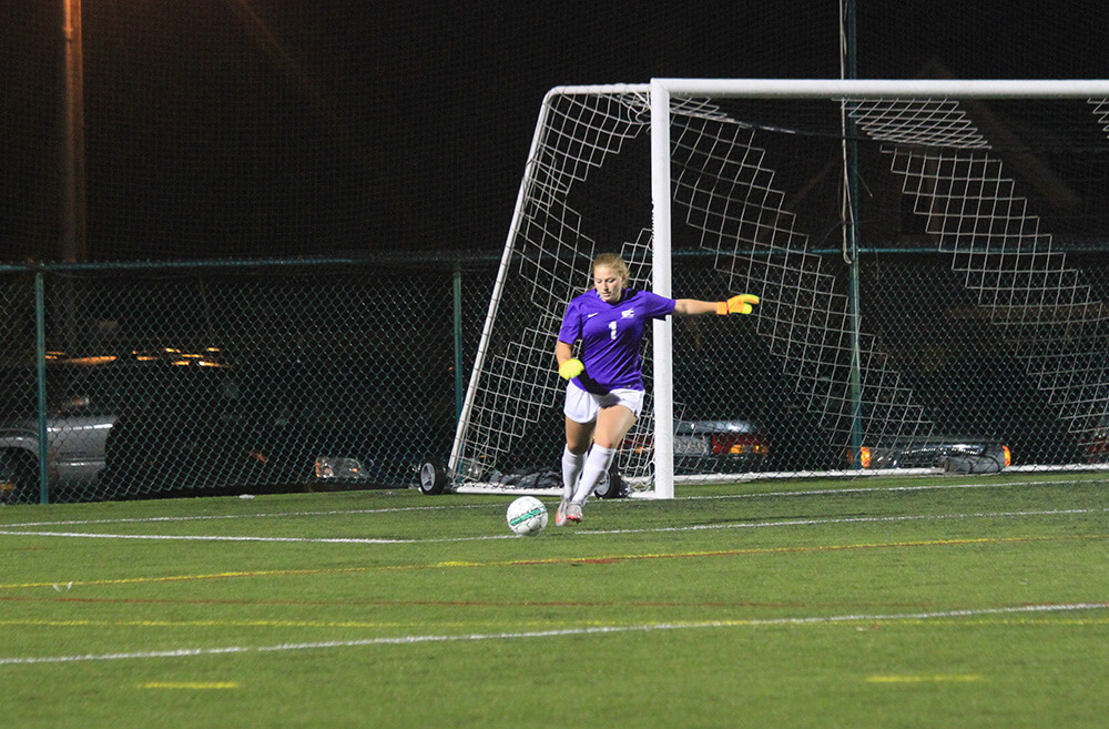 Photo of Rebecca Molin, a business management and marketing double major, and goalie of the women's soccer team