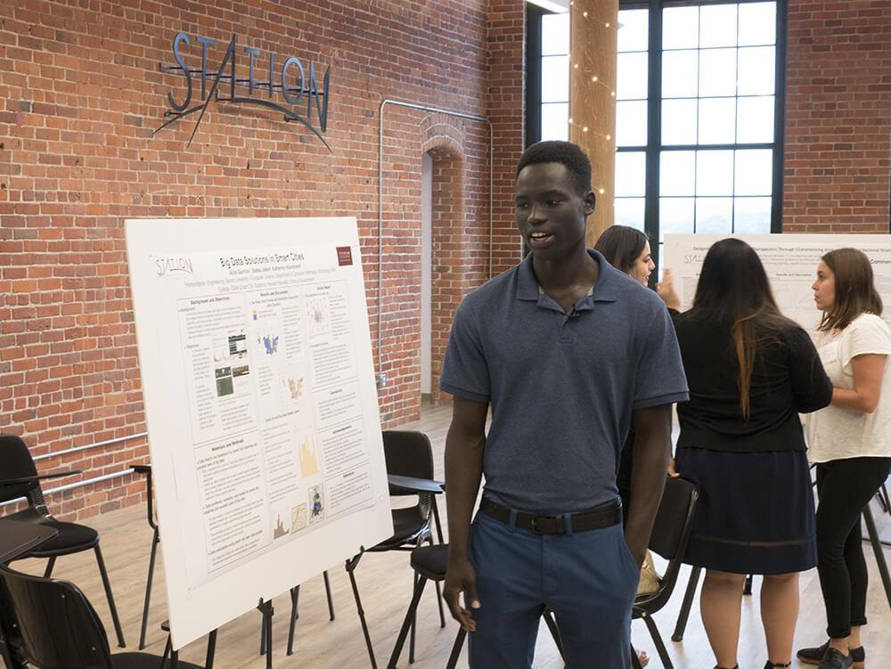 Photo of Babba Jaden '20, a CITS major, at his summer internship with Summer@Station1