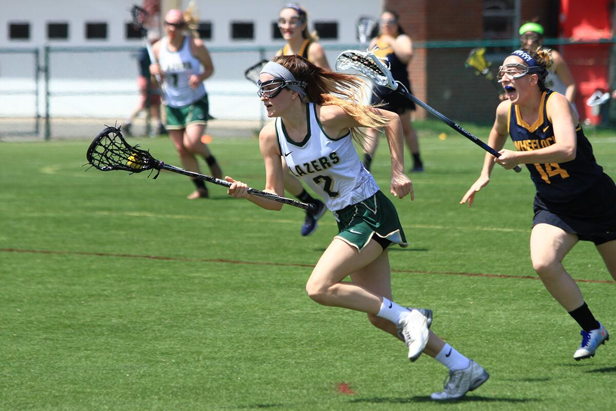 Photo of Vanessa Vurno '19 on the lacrosse field.
