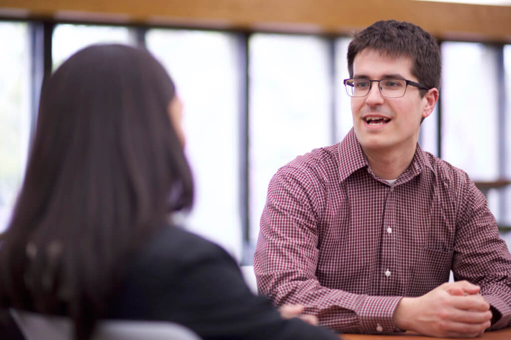 Photo of Brian Kapinos working with a student in the Center for Student Success.
