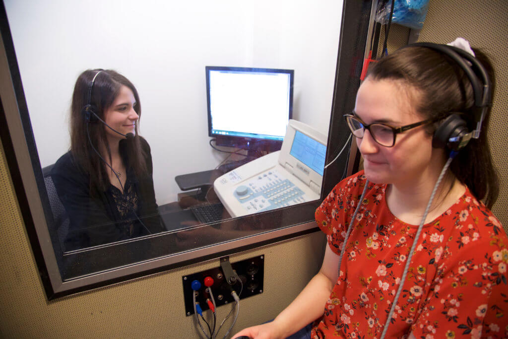 Photo of CSD majors in the sound booth_3E3C4967