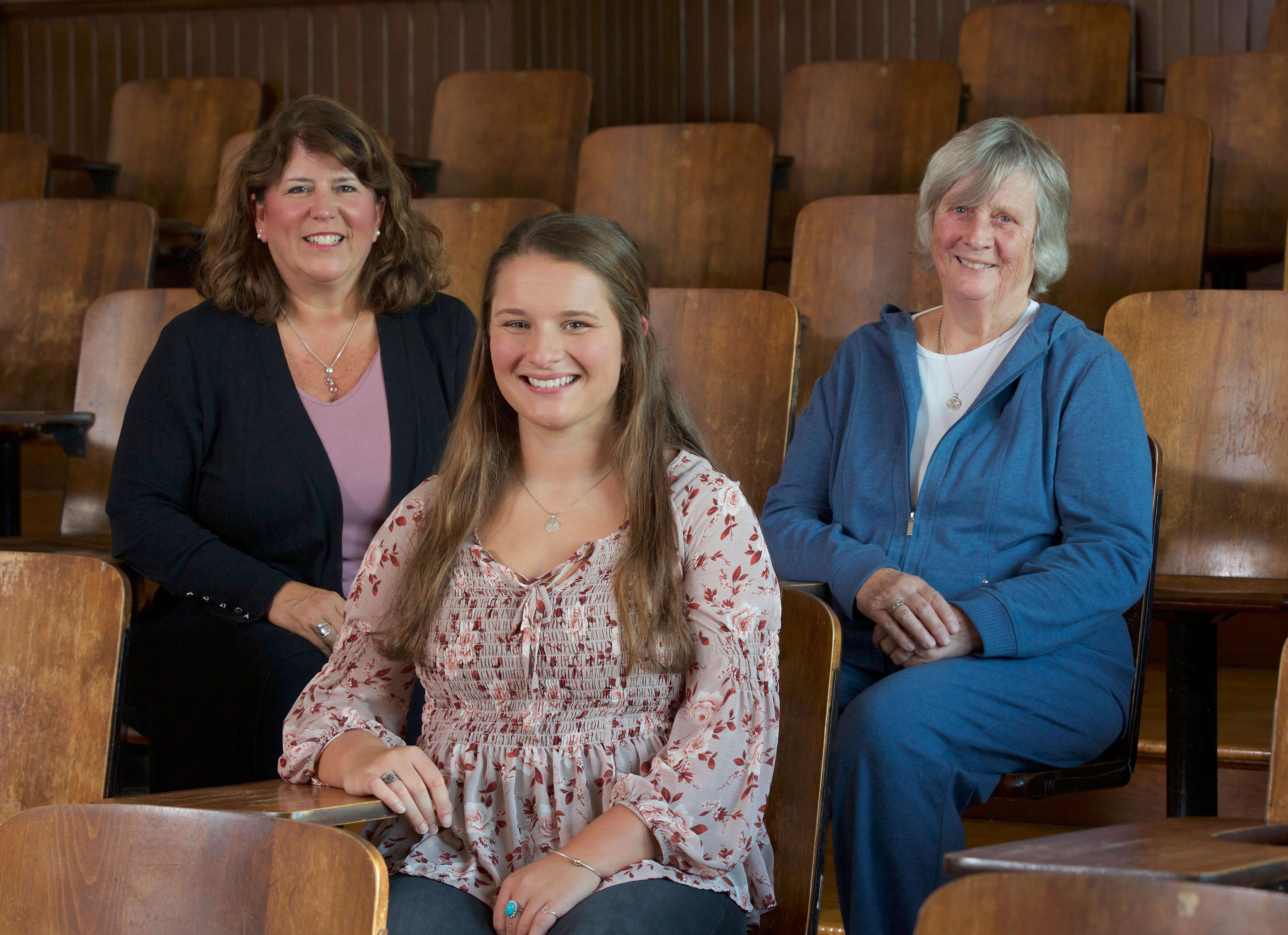 Photo of the Denault family; Tara Denault, M.Ed. '96 (left), Shannon Denault '19, and Joyce Denault '60.