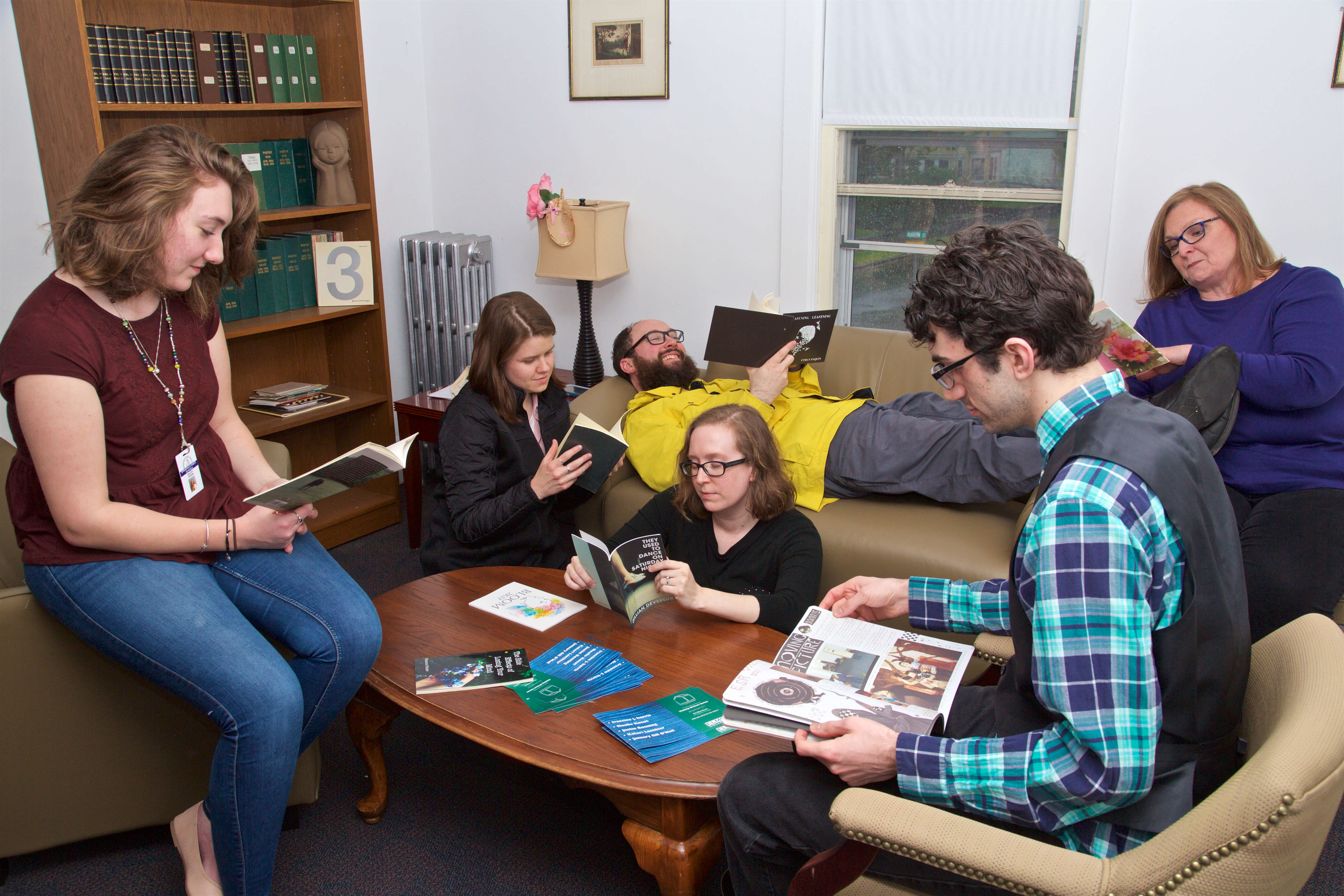 Photo of students reading and meeting in the Blue House