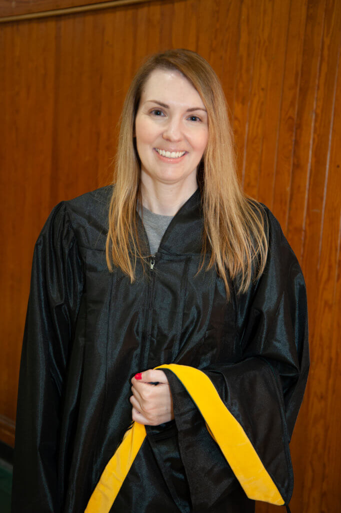 Photo of a student at commencement