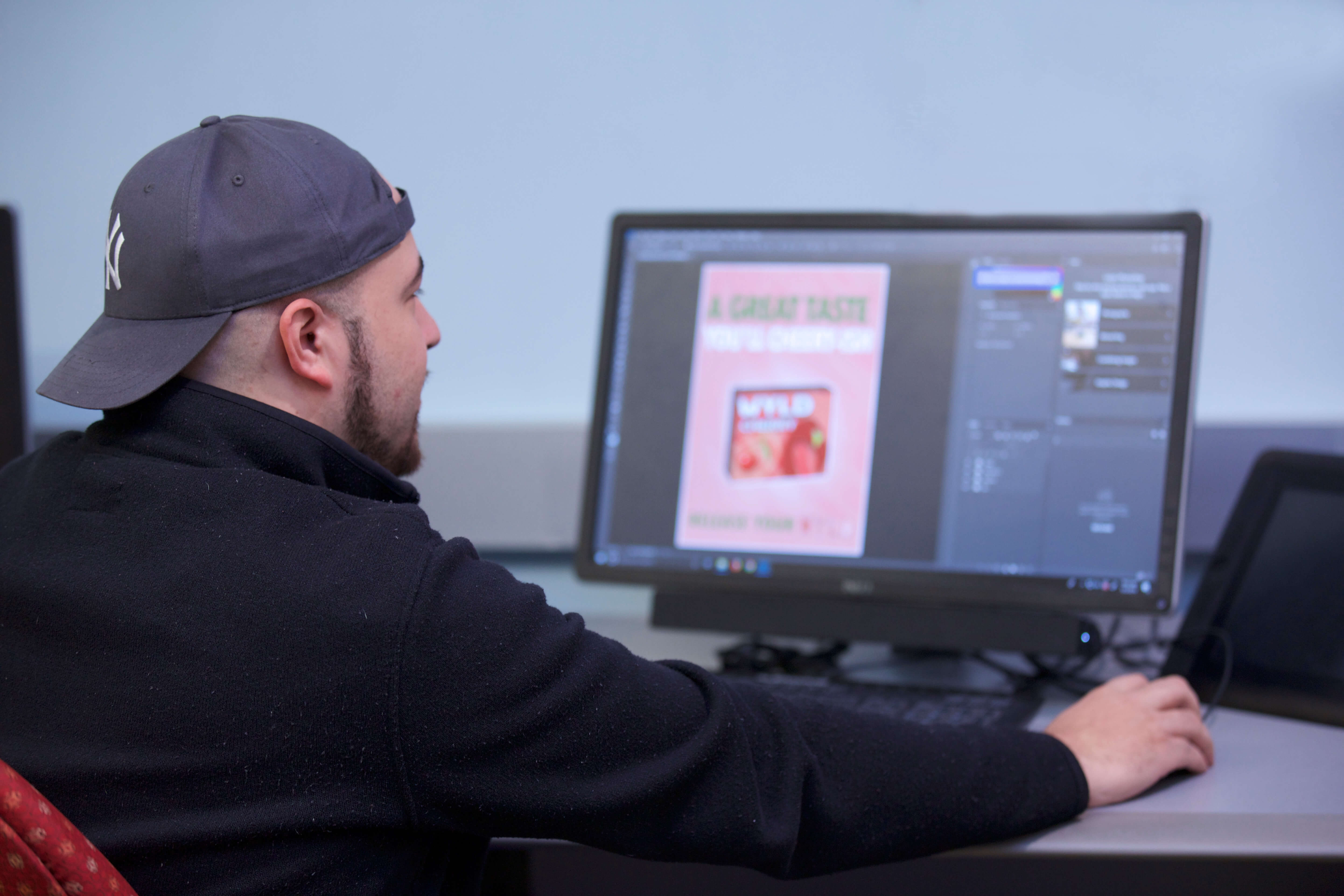 Photo of a graphic design student in the CITS lab