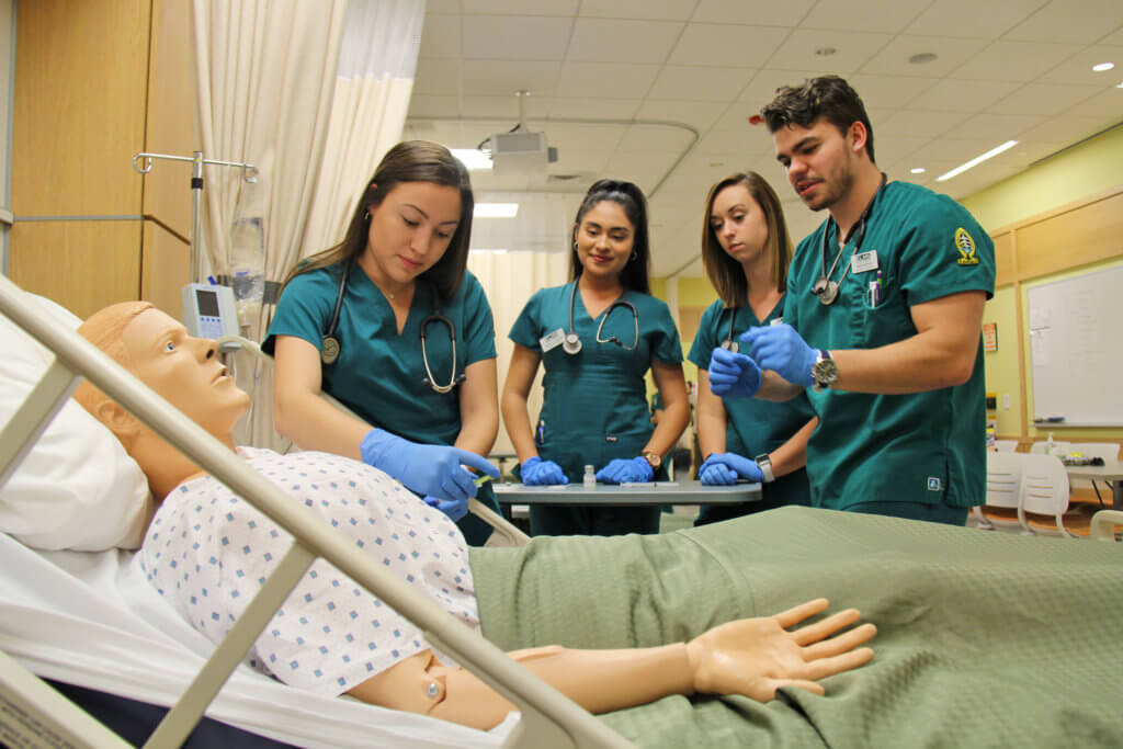 Photo of nursing students in the simulation lab