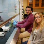 Photo of students in the research lab of the Lyons Center