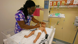 Photo of an RN-BSN student in a simulation lab at QCC