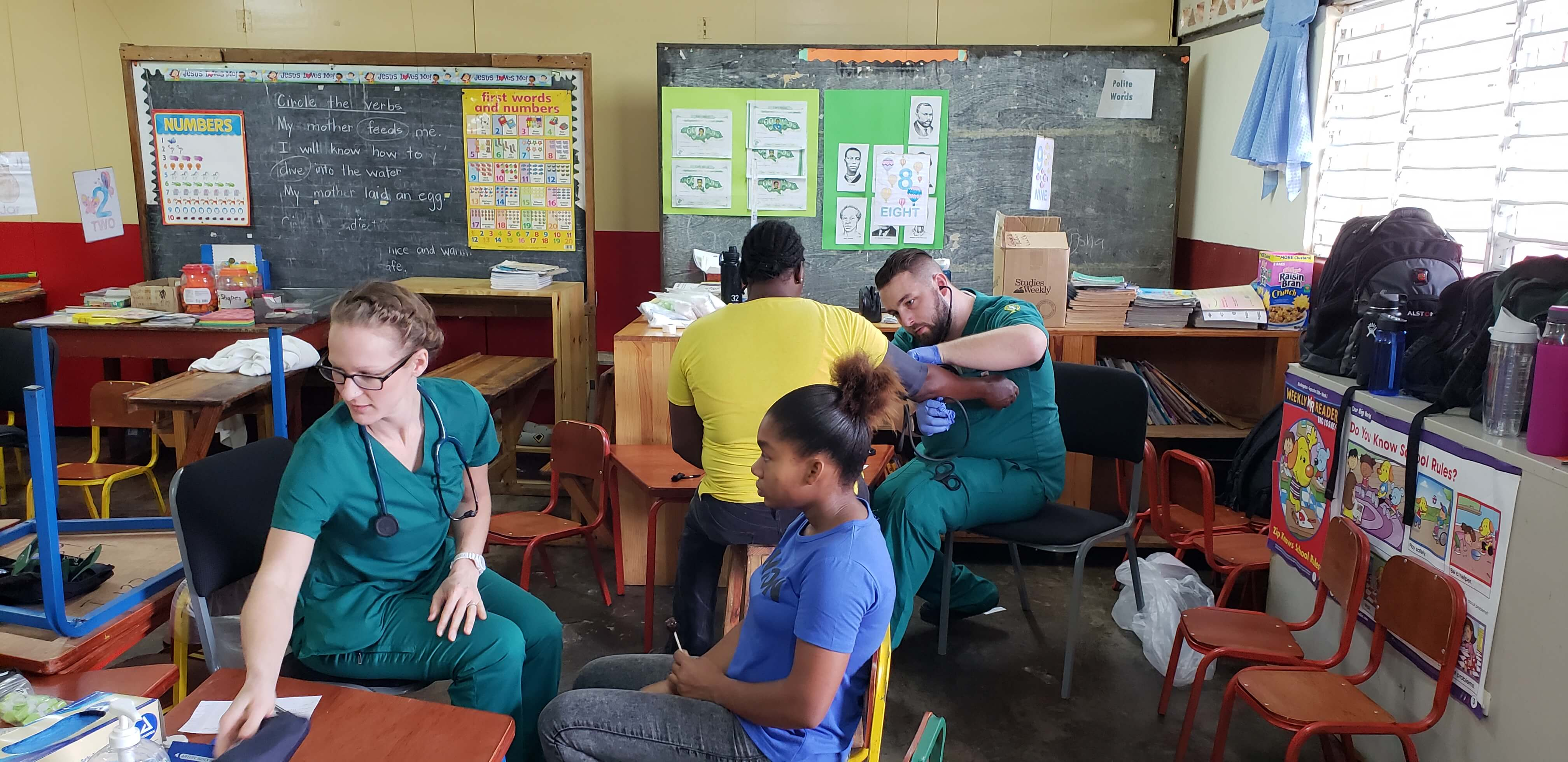 Photo of students in the accelerated second degree in nursing program, helping patients in Jamaica
