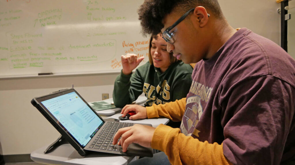 Photo of students working during the Innovation Challenge