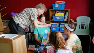 Photo of students participating in Dorothy Day program at Homework House