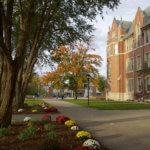 A photo of Berchmans Hall lawn in the fall