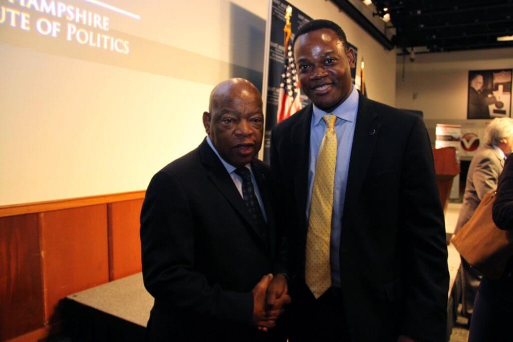 Dr. Dumay meeting Congressman Lewis at Saint Anselm College in October 2016.