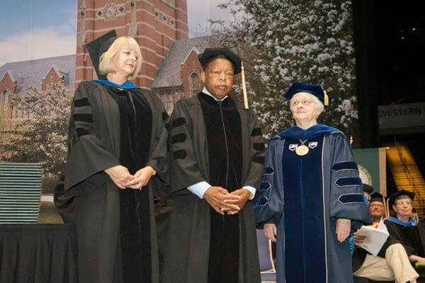 At Elms College's 2015 Commencement, Congressman John Lewis (center) stands with Cynthia Lyons (left), Elms College Board Chair and Sr. Mary Reap (right), former Elms College President.