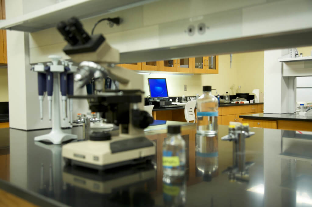 A photo of a microscope and computer in the Lyons Center research lab
