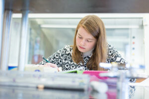Photo of a student doing research in the Lyons Center research lab