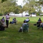 Photo of Br. Michael Duffy teaching class outside on Berchmans lawn