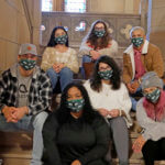 Photo of masked students in Berchmans Hall