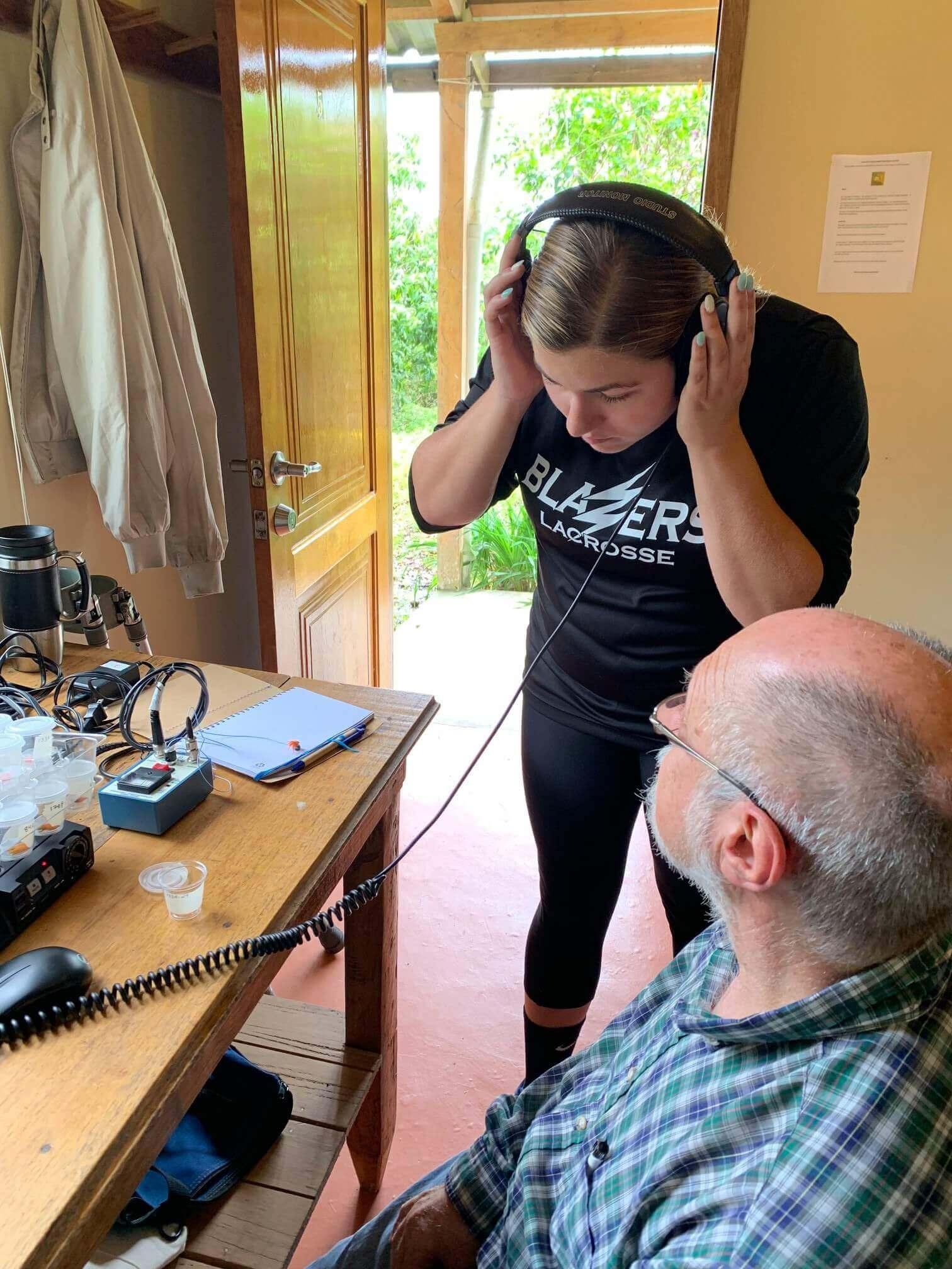 Photo of Alyssa Barnes conducting field research in Ecuador
