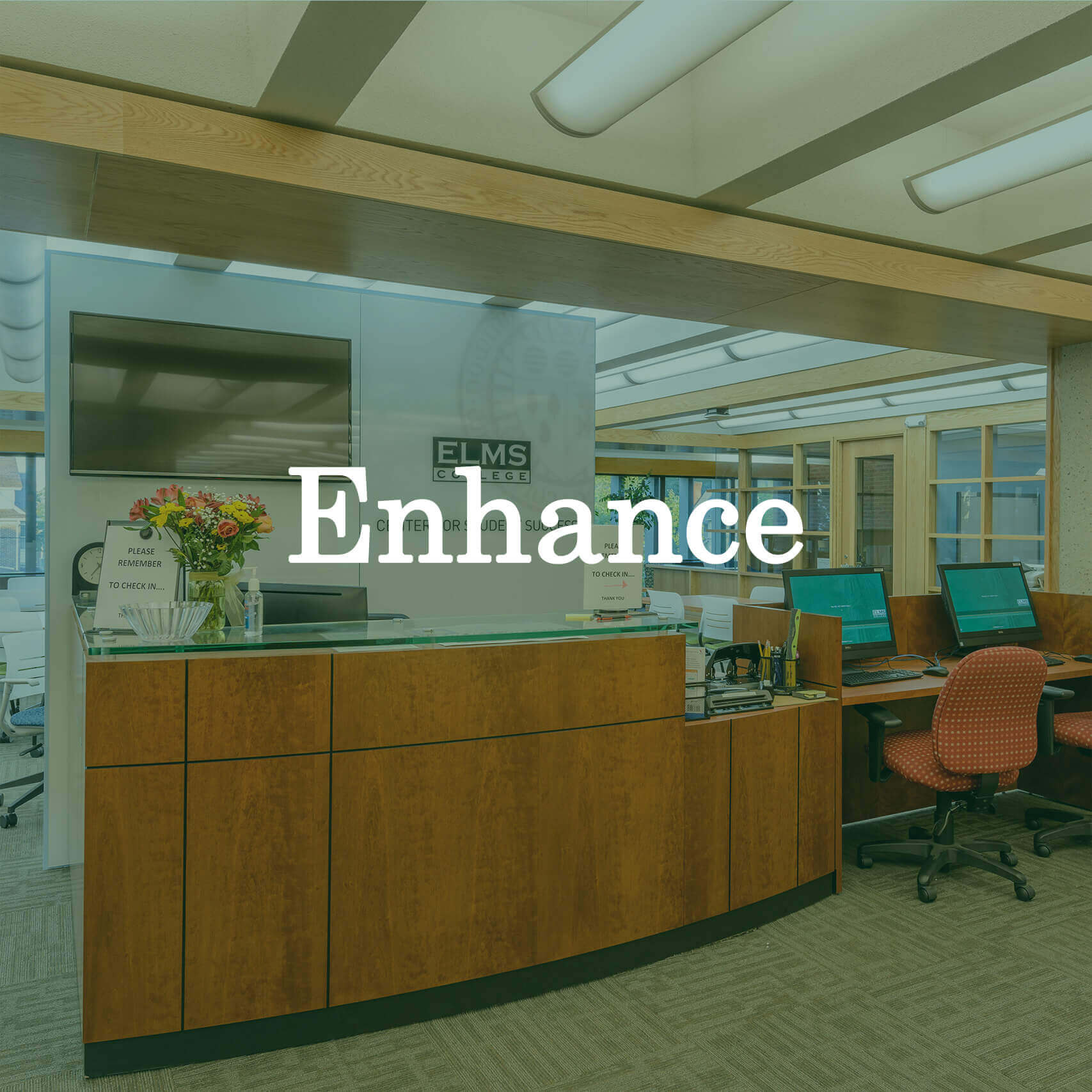 "Photo of a desk at Elms College with a text overlay that reads ""Enhance."""