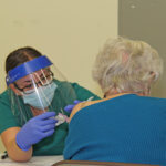 Photo of a nursing student at COVID-19 vaccine clinic
